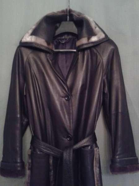 Кожаное чёрное классическое пальто с оторочкой из НЕРПЫ