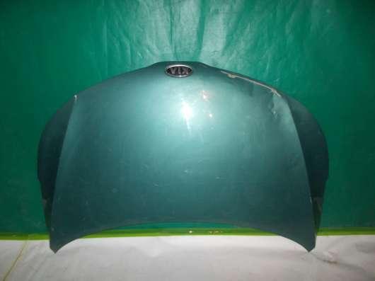 Капот на Kia Rio 3 с дефектом